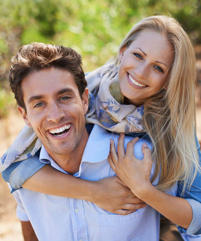 Man and woman sharing healthy smile after restorative dentistry