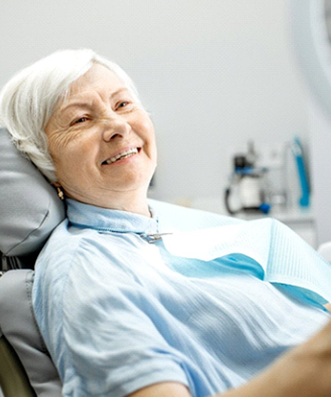Senior woman happy with the cost of dental implants in Edison