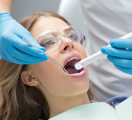 Prosthodontist capturing intraoral images