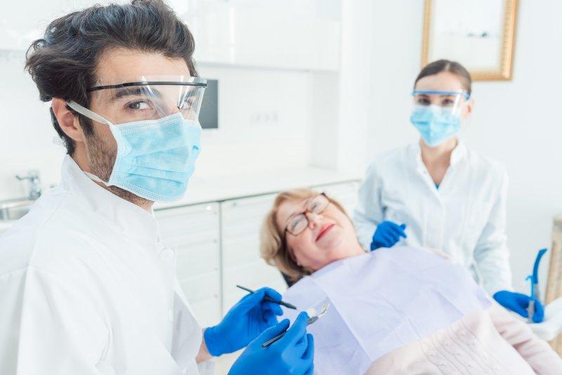 Safe dentist in Edison wearing PPE