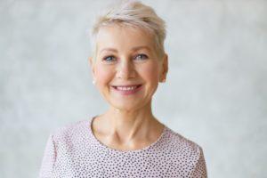 Smiling senior woman with digital dentures in Edison