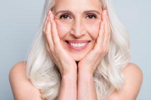 Smiling woman enjoying jawbone preservation with dental implants